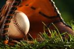 baseball and glove closeup